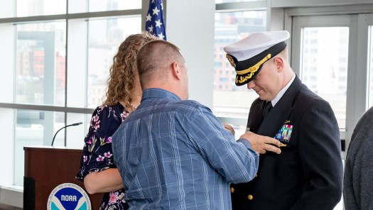 Capt. Chris van Westendorp's command pin is transferred by his best friend.