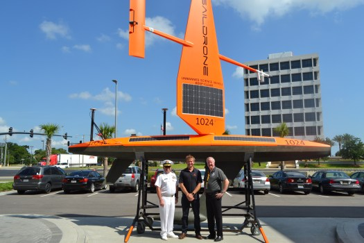 Rear Adm. Shep Smith, Richard Jenkins, and Brian Connon in front of a Saildrone.