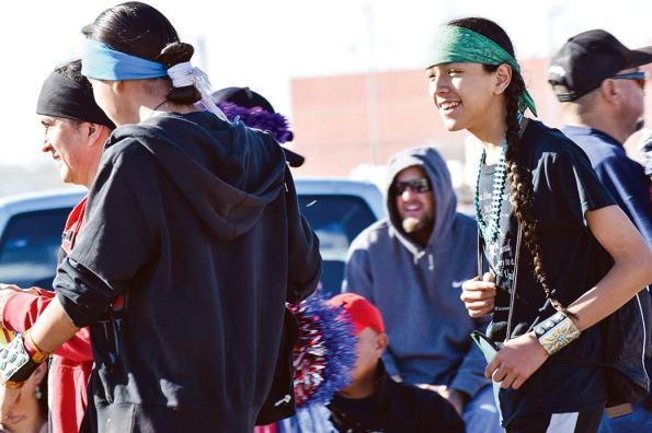 Navajo Times | Krista Allen Makairyn Marks (right) follows his brother, Makaius Marks, and their father, Darrell Marks, along the parade route during the 49th annual Western Navajo Fair on Saturday morning.