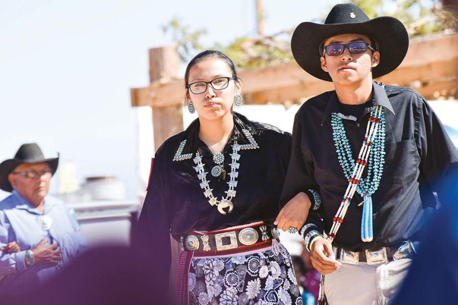 Navajo Times | Krista Allen Young friends trimmed in turquoise and silver jewelry participate in a round of two-step during the 49th annual Western Navajo Fair song and dance on Saturday evening.