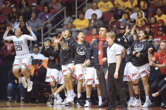 Navajo Times | Donovan Quintero The Page Lady Sand Devils celebrate after a 3-point shot increases their lead over the Monument Valley Lady Mustangs Monday during the Arizona 3A girls championship game at the Gila River Arena in Glendale, Ariz. The Lady Sand Devils defeated Monument Valley, 44-41, to win the state title.