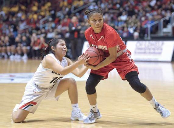 Navajo Times | Donovan Quintero Page's Mikala Benally, left, tries to take the ball away from Lady Mustang Jazlyn Lane on Monday in the Arizona 3A girls championship game at the Gila River Arena in Glendale, Ariz.