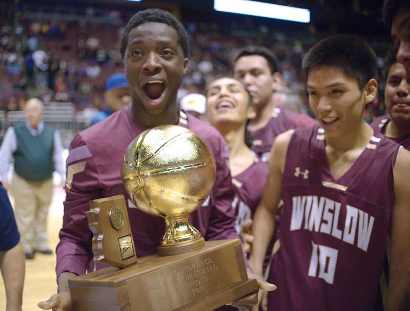 Navajo Times | Donovan Quintero Winslow Bulldogs Yoann Djassa and Darius James (10) react when the trophy is handed to them Monday after defeating the Blue Ridge Yellowjackets, 79-63, at the Gila River Arena in Glendale, Ariz.