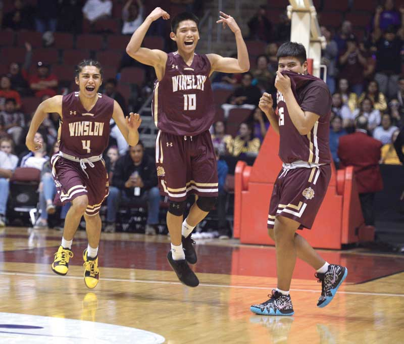 Navajo Times | Donovan Quintero Winslow Bulldogs Theron Olney, left, Darius James, center, and Dakota Spencer begin to celebrate their victory over the Blue Ridge Yellow Jackets in the Arizona 3A boys' state championship game Monday at the Gila River Arena in Glendale, Ariz.