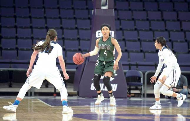 Navajo Times | Donovan Quintero Flagstaff Lady Eagle Monique Ware (4) looks for a way around a pair of Pueblo Magnet Lady Warriors on Friday during the Arizona 4A girls semifinals at the Grand Canyon University gymnasium in Phoenix.