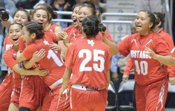 Navajo Times | Donovan Quintero The Monument Valley Lady Mustangs cheer and celebrate their victory over the Ganado Lady Hornets Friday during the Arizona 3A girls semifinals at the Gila River Arena in Glendale, Ariz.