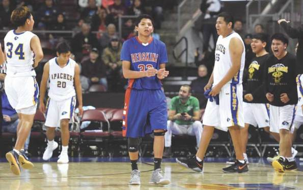 Navajo Times | Donovan Quintero Red Mesa's Tristen Tsosie claps after the game is over during the Arizona 1A boys semifinals against the Fort Thomas Apaches on Friday in Prescott Valley, Ariz.
