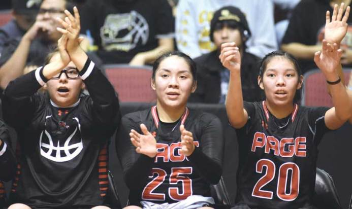 Navajo Times | Donovan Quintero Page Lady Sand Devils Jacey Salabiye, left, Lelisa Watson (25) and Myka Taliman (20) clap from the sidelines Friday during the Arizona 3A girls semifinals against the Window Rock Lady Scouts in Glendale, Ariz.