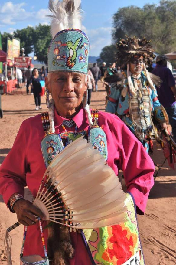 Navajo Times | Rima Krisst Phyllis Manson from Blue Gap, Arizona, prepares for Grand Entry.