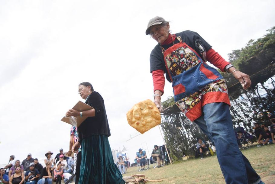 Navajo Times | Ravonelle Yazzie Mary D. Pino rushes to add another frybread to her batch during the frybread contest at the Ramah Navajo Fair and Rodeo on Aug. 25 in Pine Hill, N.M.