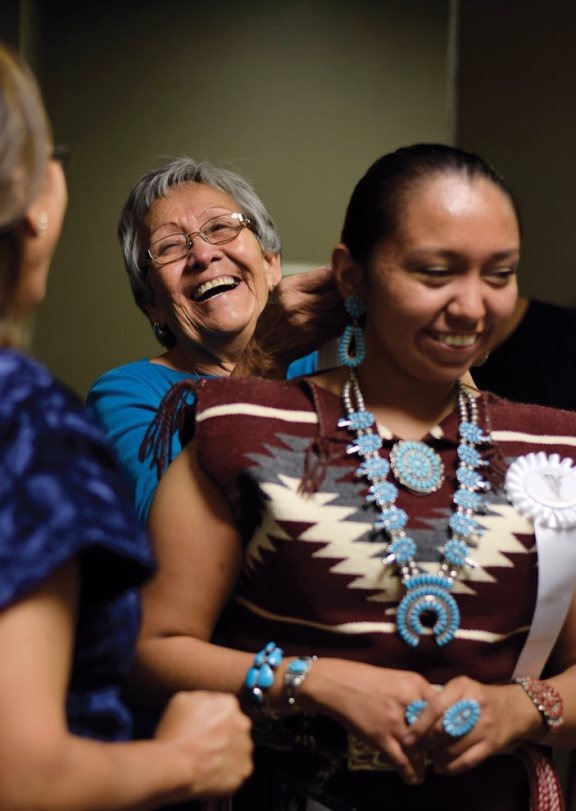 Navajo Times | Ravonelle Yazzie Ashley Claw gets help from her grandmother as she prepares to go onstage for the traditional talent competition of the Miss Gallup Inter-Tribal Indian Ceremonial pageant.