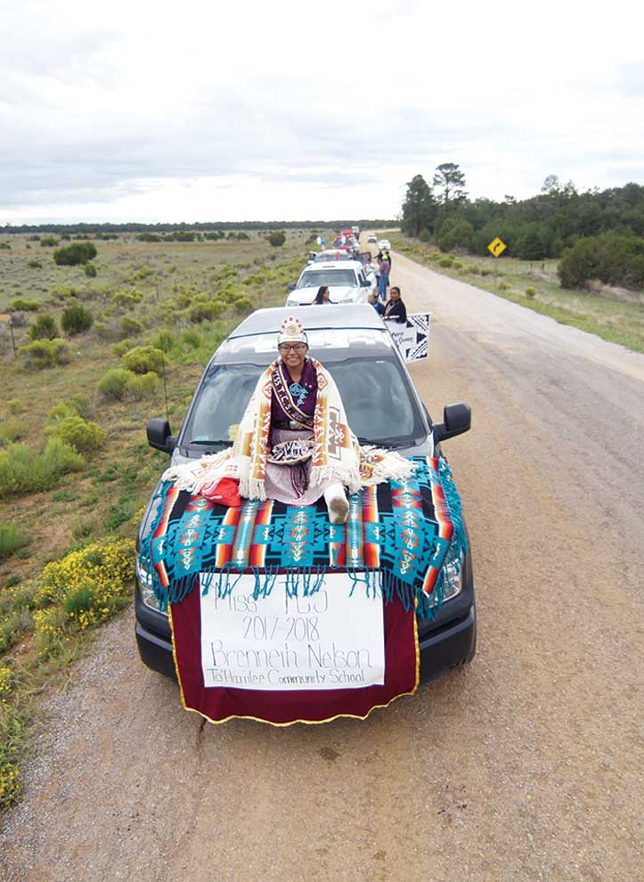 Navajo Times | Ravonelle Yazzie Brenneih Nelson, Miss To'Hajiilee Community School 2017-18, sits with a basket full of candy ready to distribute to parade goers attending the Ramah Navajo Fair and Rodeo.