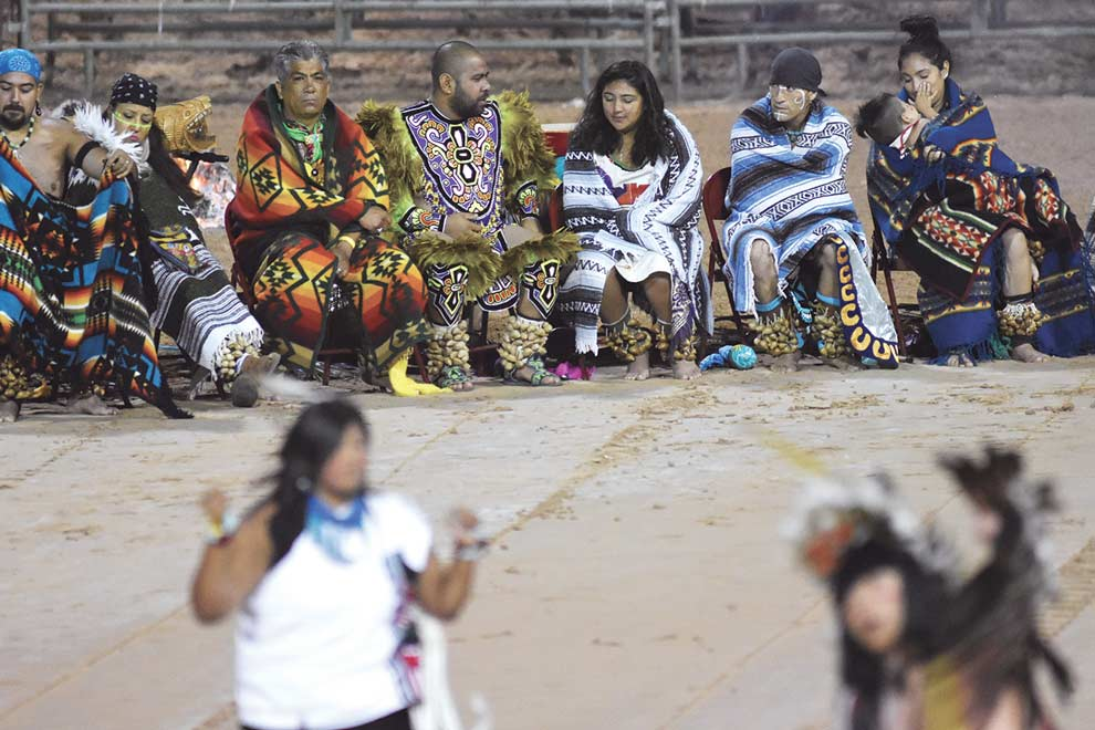 Navajo Times | Donovan Quintero Dance groups wait for their turn to perform at the night performance at the Gallup Inter-Tribal Indian Ceremonial at Red Rock Park.