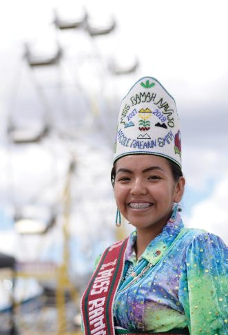 Navajo Times | Ravonelle Yazzie The outgoing Miss Ramah Navajo, Nicole Smith, spends her afternoon at the fairgrounds on Aug. 24.