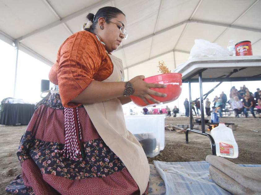 Navajo Times | Ravonelle Yazzie Miss Navajo Nation contestant Kayla Martinez sifts corn at the traditional food competition last Wednesday in Window Rock.