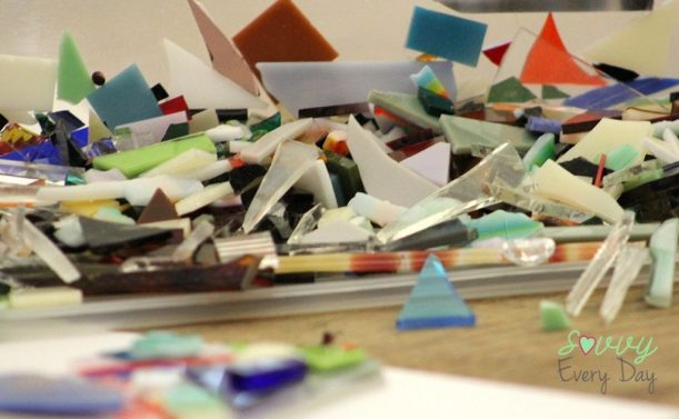 We were given bins with little pieces of glass of different colors to apply to our clear glass square.