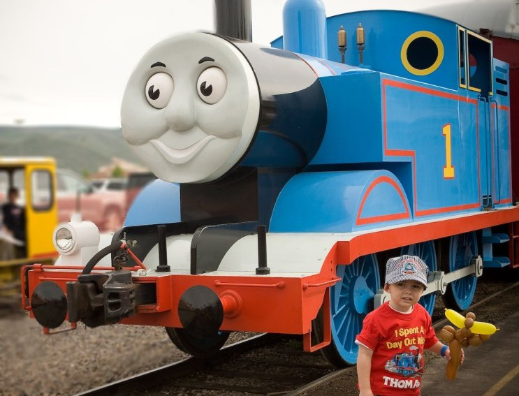 Child standing in front of Thomas the Tank Engine