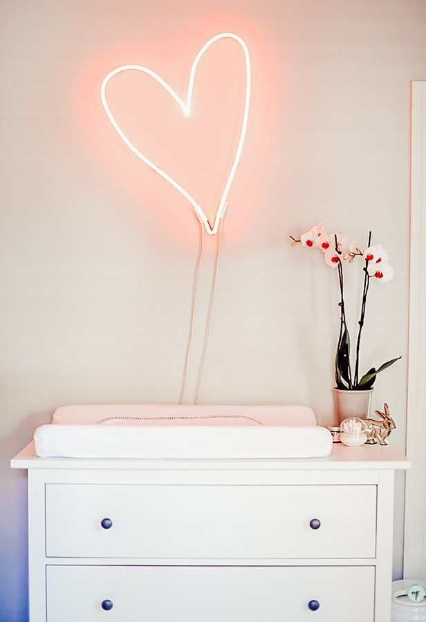 Custom heart-shaped LED light in Wonderland nursery room