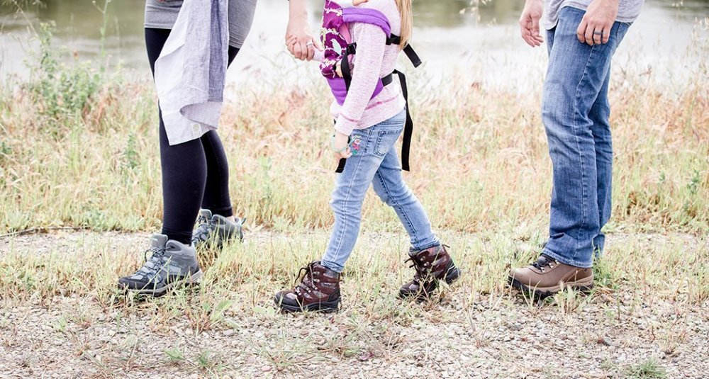 hiking as a family and holding hands