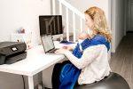 sitting on birthing ball at desk, researching things while babywearing