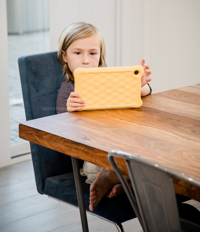 S sitting at the table with her Fire Kids Tablet