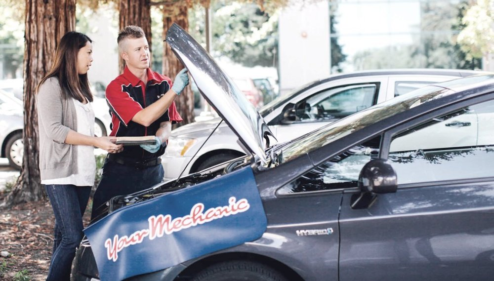 YourMechanic photo of mechanic at a car with woman