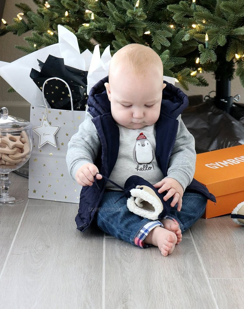 baby playing with little shoe