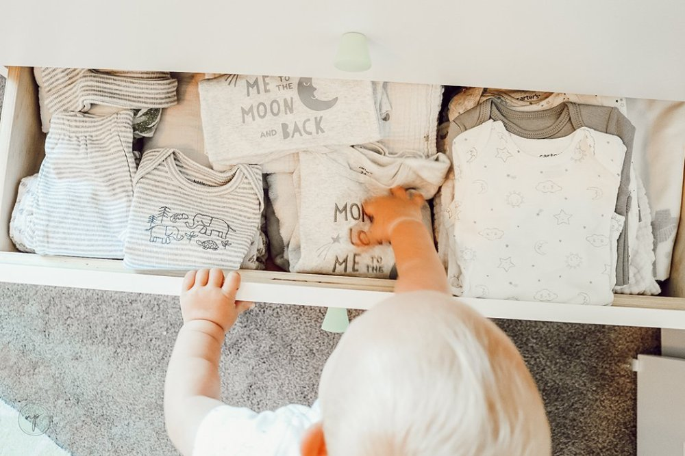 taking out moon and back baby clothes