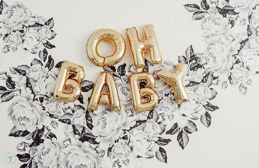 Oh Baby Balloon Sign on wall