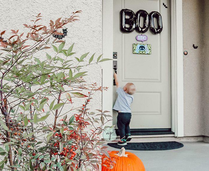 toddler trying to open front door