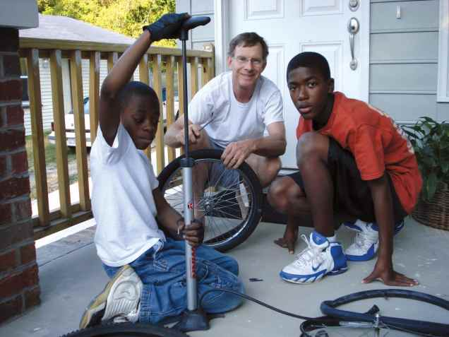 Coaching basketball and fixing bikes helps Ed Cvelich build friendships in his ministry in Walltown, North Carolina.