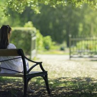 How to Have a Daily Quiet Time | The Navigators Bible Study Resources | A woman relaxing in a green garden