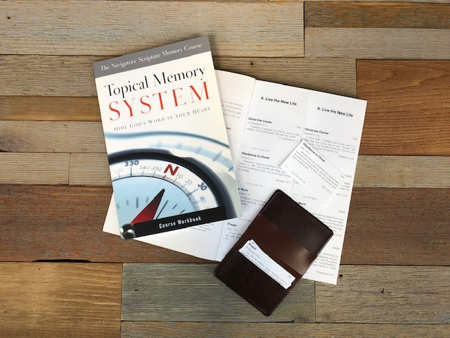 Topical Memory System (TMS) | The Navigators | Picture of the Topical Memory System (scripture memorization resource) on a wooden desk