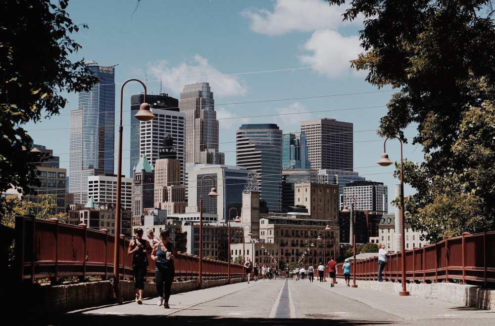 strong arch bridge Minneapolis people walking and jogging The Navigators
