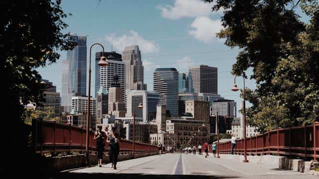 strong arch bridge Minneapolis people walking and jogging The Navigators