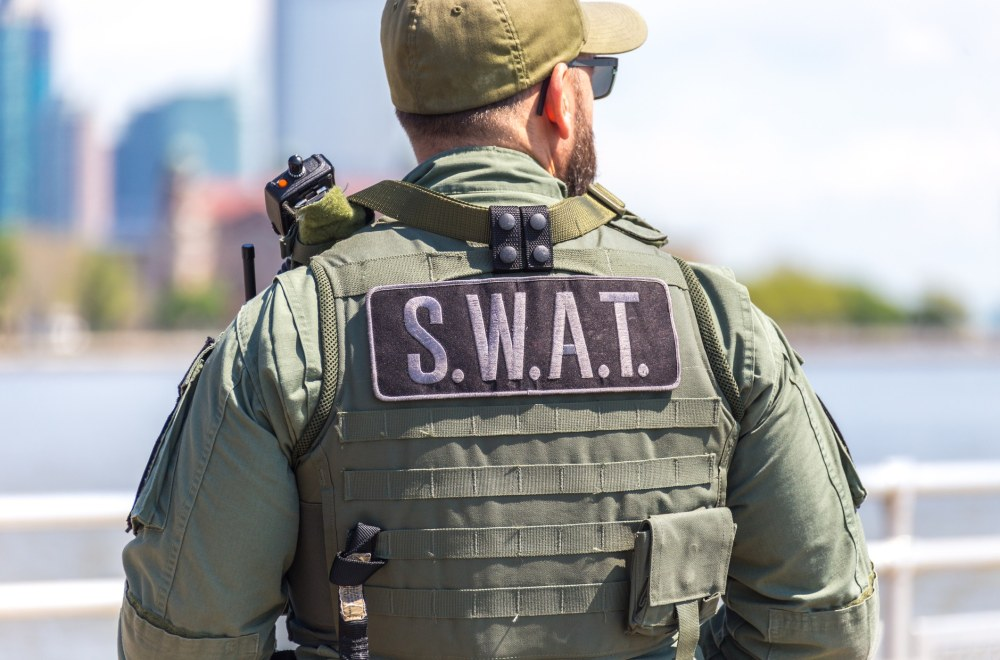 Inside the Heart of Law Enforcement: Jesus Offers Real Hope | Navigators First Responders Ministry | equipped SWAT soldier standing on a pier