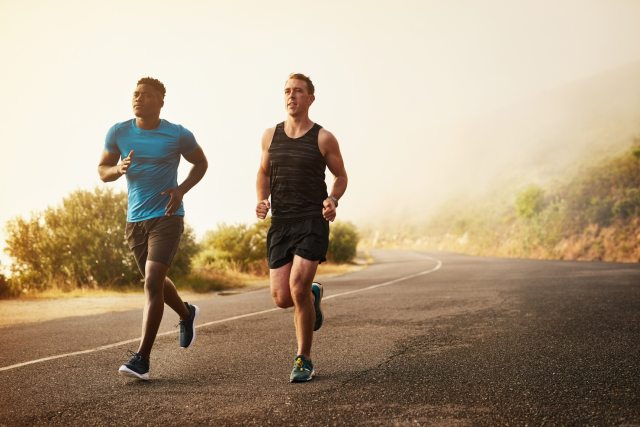 Seeking God in a Changing World   Shot of two young men out for a run together