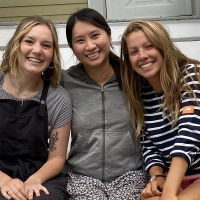 A World of God's Possibility | Navigators Collegiate Ministry | Three female Boston University students sitting on stairs