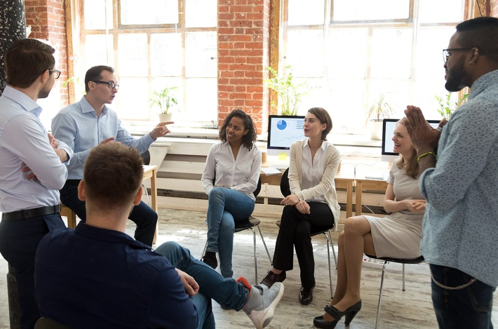 When God is in Charge of a Business: Sharing the Love of Jesus | The Navigators World Missions | Diverse group of employees having a conversation