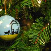 Christmas Hope: Our Inrushing Rescuer | Doug Nuenke | Nativity ornament on a Christmas tree