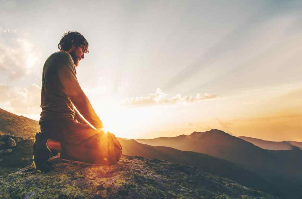 Navigators Prayer Guide 2021 | The Navigators Prayer Resource | Man relaxing at sunset mountains Travel Lifestyle spiritual emotional meditating concept vacations outdoor harmony with nature landscape