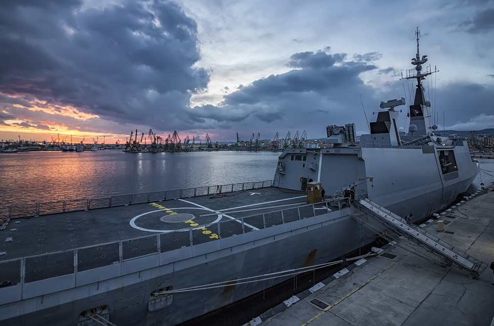 Next Door To Our Military | The Navigators Military | Part of frigate naval forces at sunset at the port