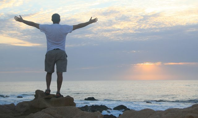 Experience the Life-Giving Love of Jesus | Navpress | Man praisng on the beach in the morning