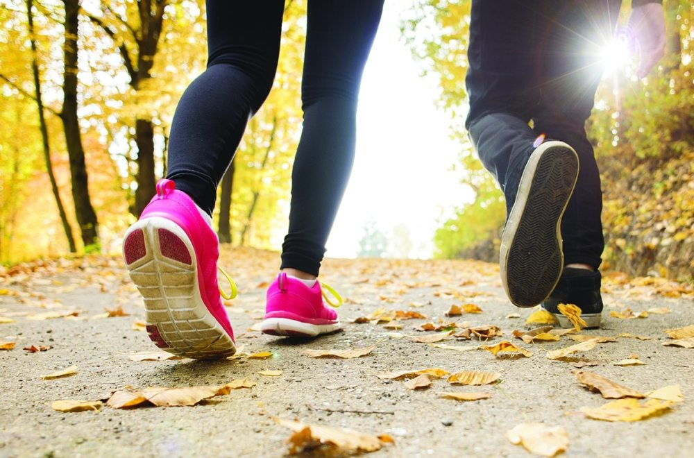 Simple Principles for Everyday Disciplemaking | The Navigators Churches | Feet walking on a path in Fall