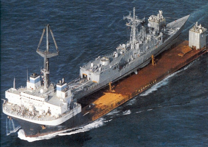 The heavy-lift ship MV Mighty Servant bears the damaged USS Samuel B. Roberts (FFG 58) on the journey from Dubai to Newport, R.I. (U.S. Navy photo)
