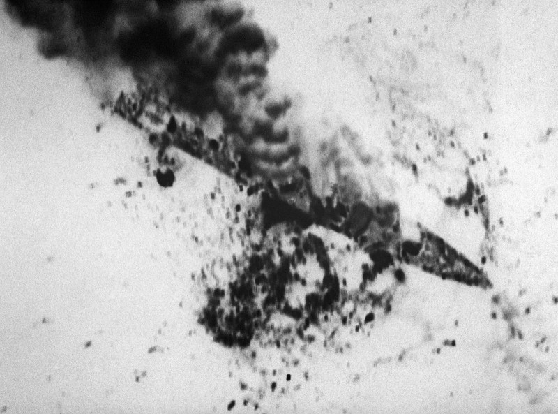 The Iranian frigate IS SAHAND (74) burns after being attacked by aircraft of Carrier Air Wing II from the nuclear-powered aircraft carrier USS ENTERPRISE (CVN-65) in retaliation for the mining of the guided missile frigate USS SAMUEL B. ROBERTS (FFG-58). The ship was hit by three Harpoon missiles plus cluster bombs.