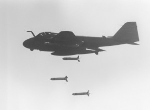 An A-6E Intruder aircraft drops CBU-59 cluster bombs over Iranian targets.