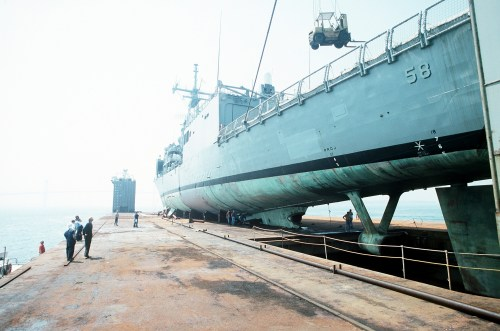 A port quarter view of the guided missile frigate USS SAMUEL B. ROBERTS (FFG-58) secured on the deck of the Dutch salvage ship MIGHTY SERVANT II.  The MIGHTY SERVANT II is transporting the frigate back to its home port in Newport, R.I., after it struck a mine in the Persian Gulf on 14  April 1988.