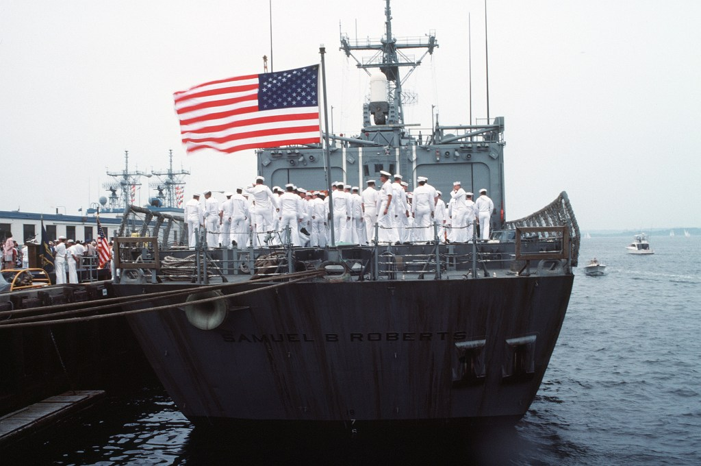 Tied to a pier at the Newport naval station,<i>Roberts</i>is home at last.(PH2 Elliott/U.S. Navy)