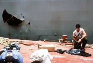 A sailor takes a break near a hole in the Stark's hull in the Persian Gulf in 1987.